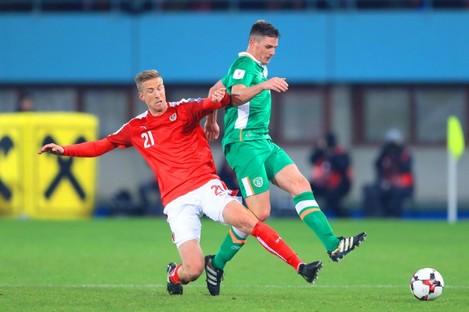 Austria's Marc Janko (left) and Republic of Ireland's Ciaran Clark battle for the ball.