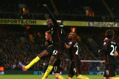 Yaya Toure celebrates scoring.