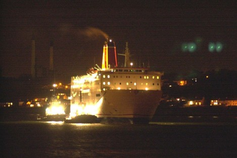Stena Europe is tugged into Pembroke Dock in 2003, after engine failure.