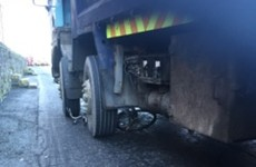 Cyclist escapes with her life after truck crushes her bike