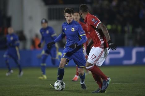 Rostov's Dmitri Poloz, left, controls a ball next to Bayern's Jerome Boateng.