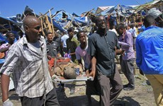 At least 11 people killed in 'horrific' bombing at busy Somali market
