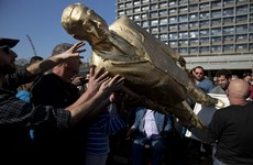 Israelis have toppled a huge golden statue of Benjamin Netanyahu in Tel Aviv