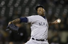 Controversial Chapman returns to the Yankees on an $86 million contract