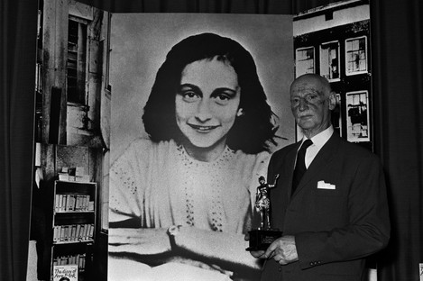 "Dr Otto Frank holds the Golden Pan award, given for the sale of one million copies of the famous paperback The Diary of Anne Frank""."