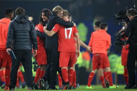 Liverpool manager Jurgen Klopp and Liverpool's Ragnar Klavan embrace after the final whistle.
