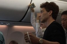 80s singer Richard Marx helps restrain unruly passenger with rope on board Korean airplane