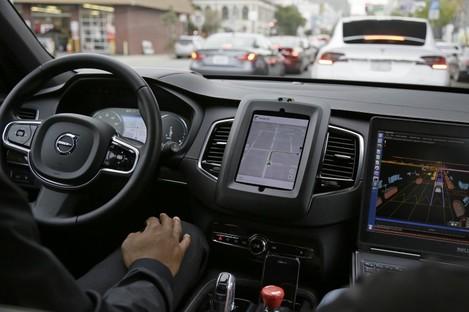 An Uber driverless car waiting in traffic