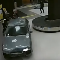 Russian man who drove his car into an airport says he did it for love