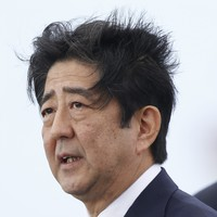 Japanese PM offers 'everlasting condolences' but holds back from full apology at Pearl Harbor