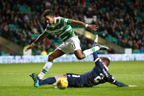 Celtic's Scott Sinclair is tackled by Ross County's Marcus Fraser.