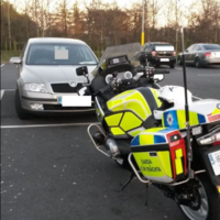 Driver to appear in court after turning from checkpoint and speeding off on wrong side of the road