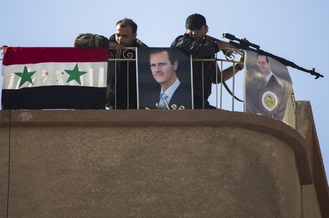 File photo of Syrian soldiers keeping watch in a town on the northern outskirts of Damascus.
