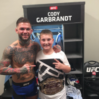 Cody Garbrandt lights up fan's night as he gives his belt to cancer survivor