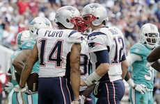 Brady leads Patriots to AFC top spot with win over Dolphins