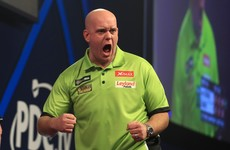 Phenomenal Van Gerwen smashes record average to book World Championship final spot
