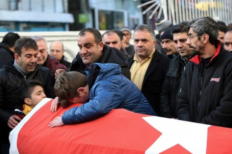 Family members and friends mourn as they attend funeral prayers for Ayhan Akin, one of the victims.