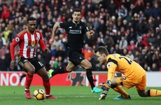 Defoe bags two penalties to force a draw against Liverpool