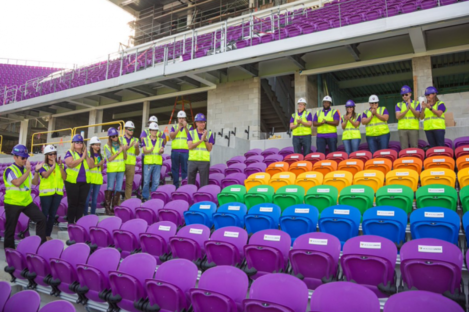 Staff at Orlando City unveil the 49 rainbow-coloured seats at their stadium.
