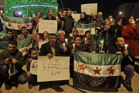Lebanese and Syrian activists hold a candle light vigil and Syrian revolution flags in downtown Beirut, Lebanon, on New Year's Eve