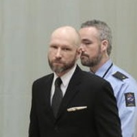 Norwegian mass murderer makes Nazi salute as court reviews 'inhumane' prison regime