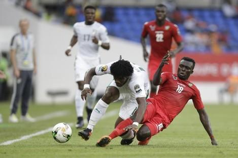 Ivory Coast's Franck Yannick Kessie, left, is challenged by Togo's Atakora Lalawewe.