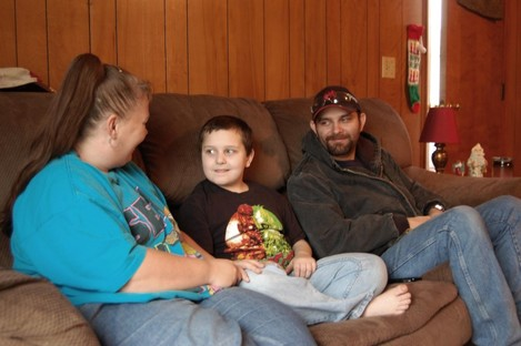 Kentucky mother Sandra Baker, left, sits with her son, Christopher, and husband, Scottie at Sandra's home in Harrodsburg, Kentucky