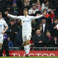 Liverpool's title hopes dealt major blow as struggling Swansea stun Anfield