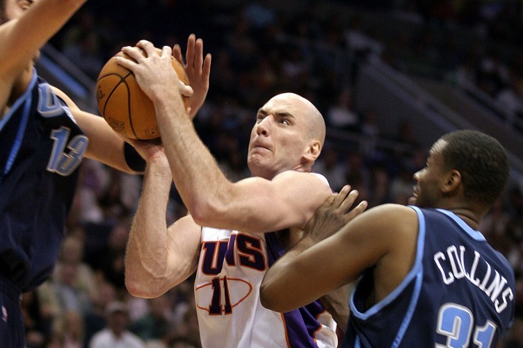 Pat Burke takes it to the hoop for the Suns.