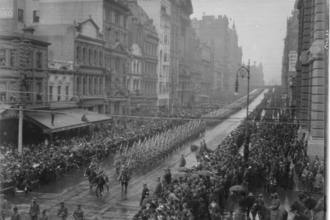 Soldiers marching down Collins Street in Melbourne
