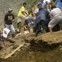 Landslide kills 25 and buries dozens more in Philippines