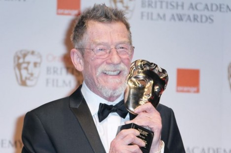 John Hurt poses with the award for 'Outstanding Contribution to Cinema' backstage at the Bafta Film Awards, 2012