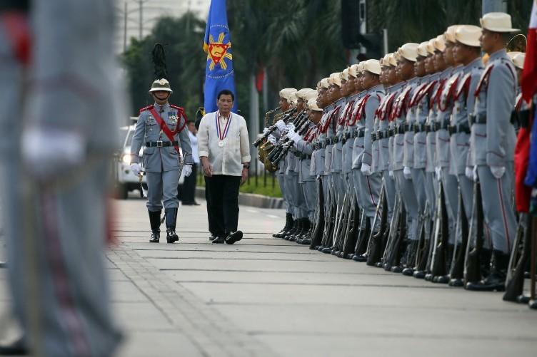 Philippine President Rodrigo Duterte reviews the troops.