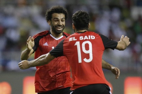 Egypt's Mohamed Salah, left, celebrates after scoring the opening goal.