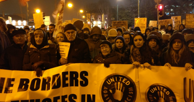 Hundreds brave wind and rain for anti-Trump protest in Dublin