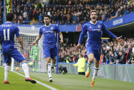 Marcos Alonso celebrates his goal.