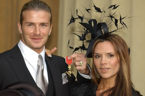 David Beckham with his wife Victoria after receiving the OBE (Officer of the Order of the British Empire) from Queen Elizabeth II at Buckingham Palace in 2003.