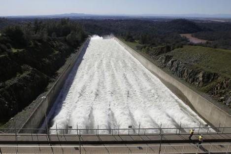 Water flows down Oroville Dam's main spillway.