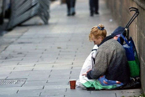 A homeless woman with a child begging on Nassau Street,