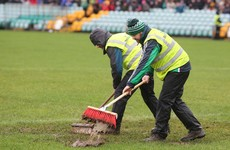 Is there anything more Irish than sweeping the rain off the pitch for a match?
