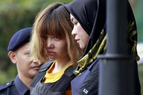 Vietnamese suspect Doan Thi Huong in a yellow t-shirt and bullet-proof vest.