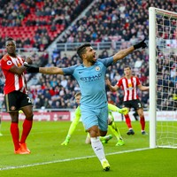 Aguero and Sane strike to keep Man City's slim title hopes alive
