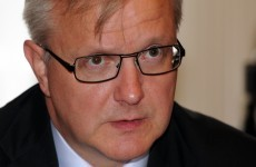 Rehn slams 'inconsistent' credit rating downgrade
