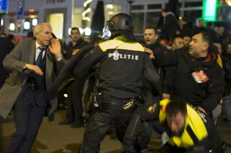 Demonstrators battle with Dutch riot police after riots broke out near the Turkish consulate in Rotterdam, Netherlands.