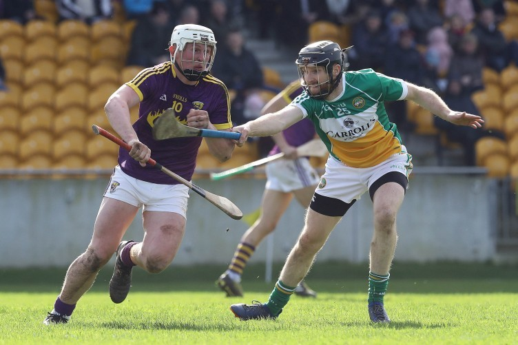 James Mulrooney and Aaron Maddock battle for possession.