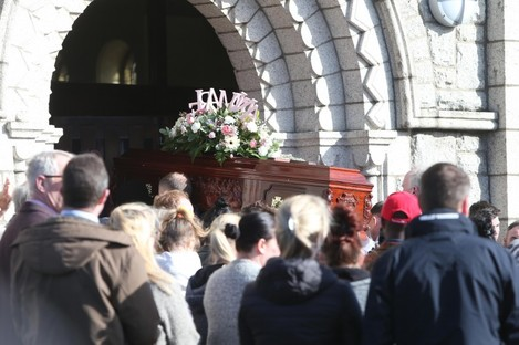 The coffin of Annmarie O'Brien is taken into St Anne's Church.