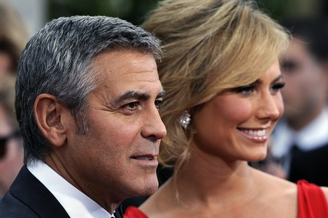 George Clooney and Stacy Keibler arrive at the 69th Annual Golden Globe Awards last night. Clooney won Best Actor