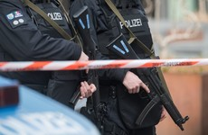German police make two arrests after hostage taken at bank