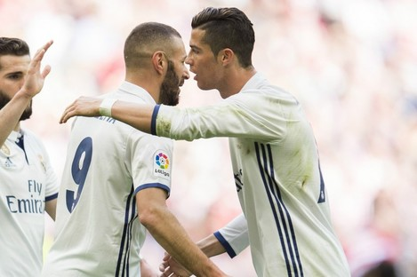 Karim Benzema celebrates with Cristiano Ronaldo at San Mames