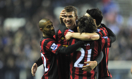 The City players celebrate Dzeko's goal.